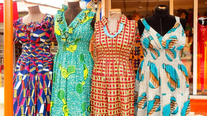 Dresses at an outdoor  market in Accra Ghana West Africa.