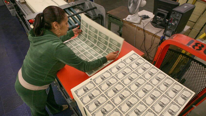 WASHINGTON - MARCH 26:  Angela Jones inspects sheets of soon to be one dollar bills before they are cut into singles at the Bureau of Engraving and Printing on March 26, 2009 in Washington, DC.