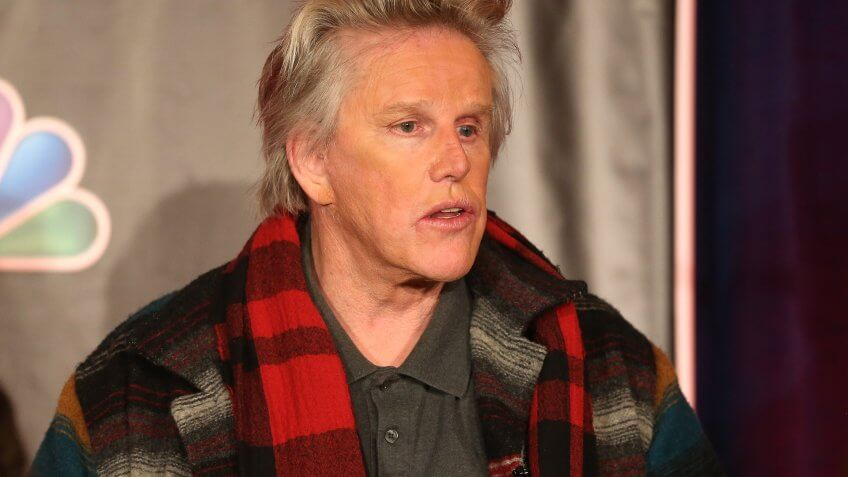 "PASADENA, CA - JANUARY 06:  Actor Gary Busey speaks onstage at the ""All Star Celebrity Apprentice"" breakfast session during the NBCUniversal portion of the 2013 Winter TCA Tour- Day 3 at the Langham Hotel on January 6, 2013 in Pasadena, California."
