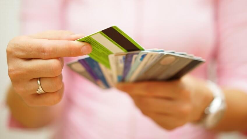 woman choose one credit card from many, concept of  credit card debt,.