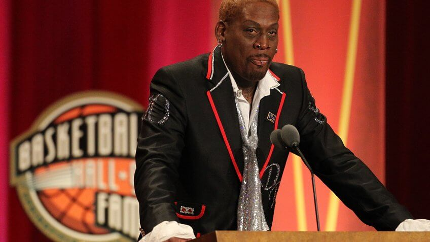 SPRINGFIELD, MA - AUGUST 12:   Dennis Rodman gestures during the Basketball Hall of Fame Enshrinement Ceremony at Symphony Hall on August 12, 2011 in Springfield, Massachusetts.