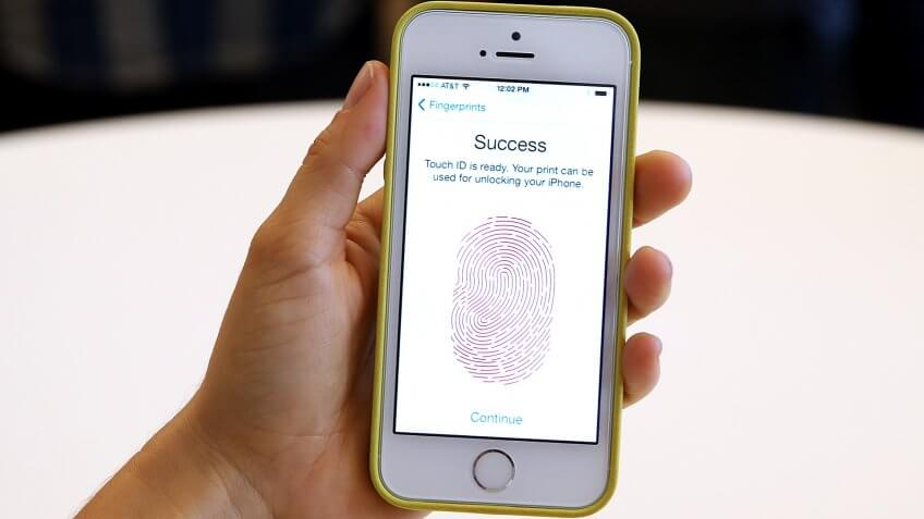 CUPERTINO, CA - SEPTEMBER 10:  The new iPhone 5S with fingerprint technology is displayed during an Apple product announcement at the Apple campus on September 10, 2013 in Cupertino, California.