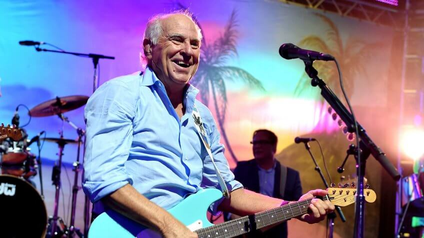"""LOS ANGELES, CA - JUNE 09:  Musician Jimmy Buffett performs at the after party for the premiere of Universal Pictures' """"Jurassic World"""" at Hollywood & Highland on June 9, 2015 in Los Angeles, California."""