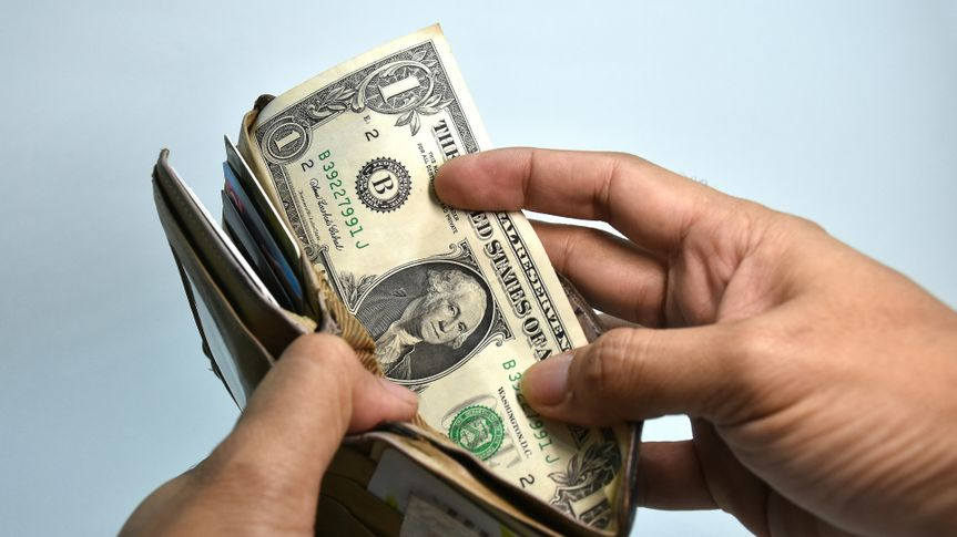 pulling cash from a wallet