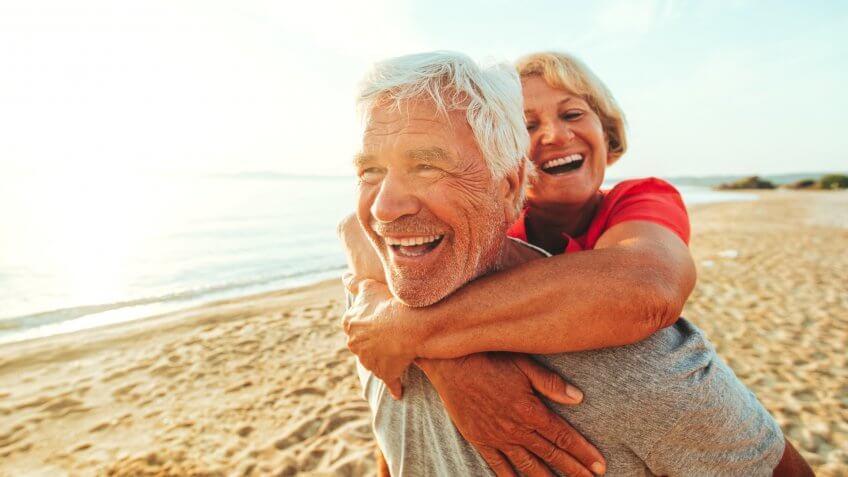 A senior couple seen having fun at the beach on a nice day.