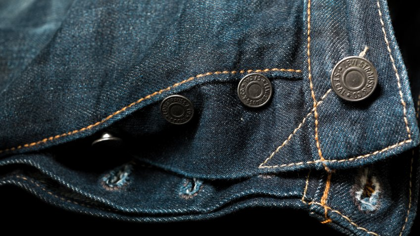 Istanbul,Turkey - February 19,2015 : Close up of the Levi's denim jeans and its buttons and rivets which reflects it's ruggedness.