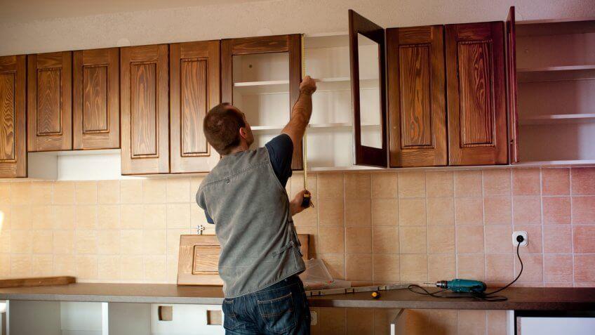 Carpenter working on new kitchen cabinets.