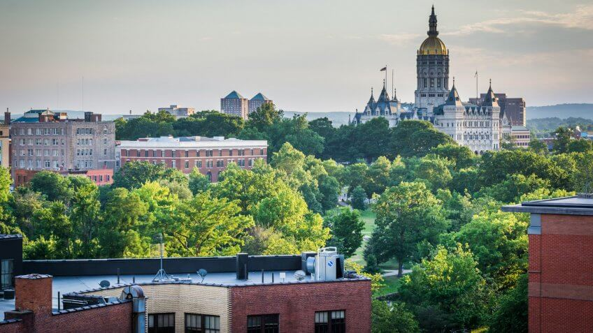 View of buildings and the Connecticut State Capitol Building in Hartford, Connecticut.