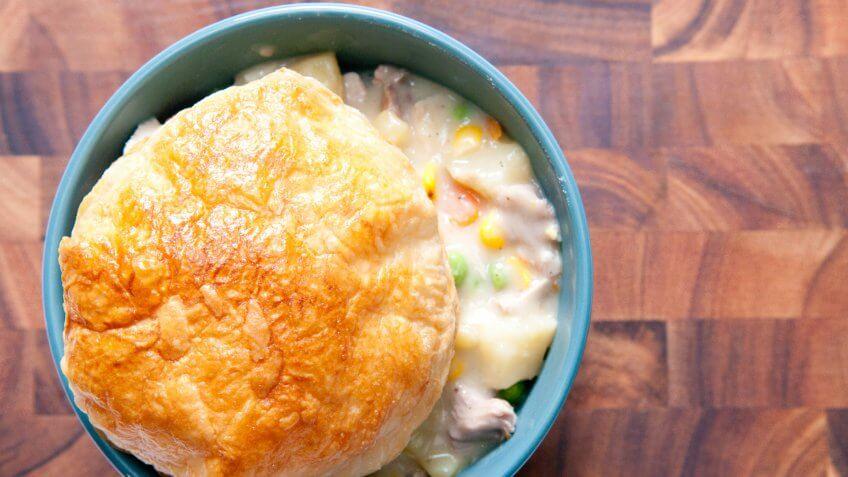 savoury turkey pot pie with flaky pasty top.