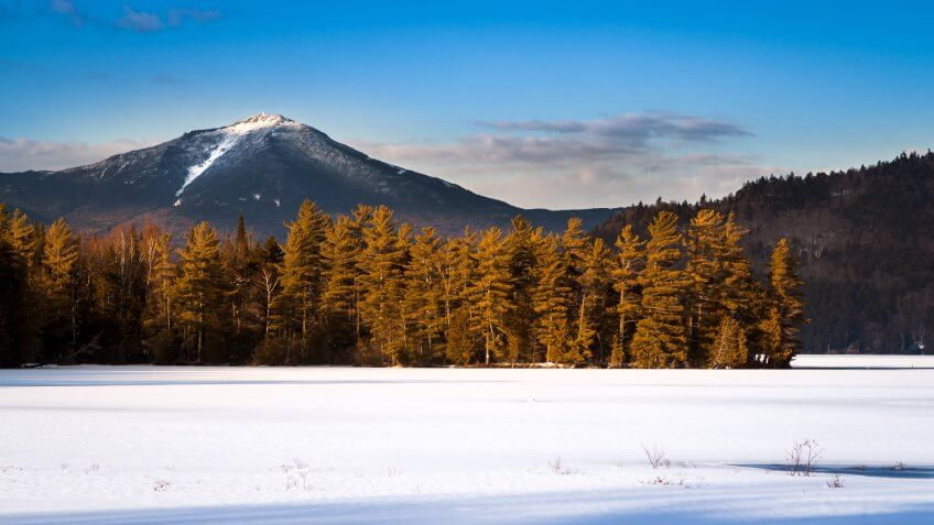 Whiteface mountain peak viewed from the frozen Paradox Bay in Lake Placid, Upstate New York.