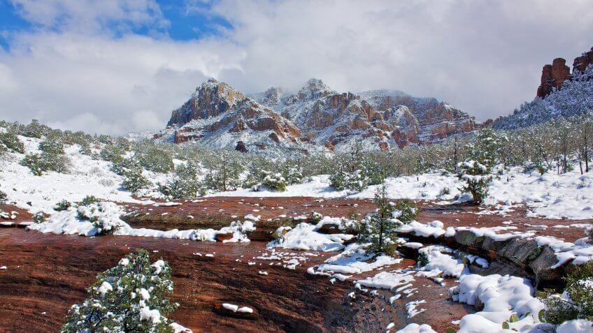 a rare snowstorm covers the red rock country of sedona arizona in white.