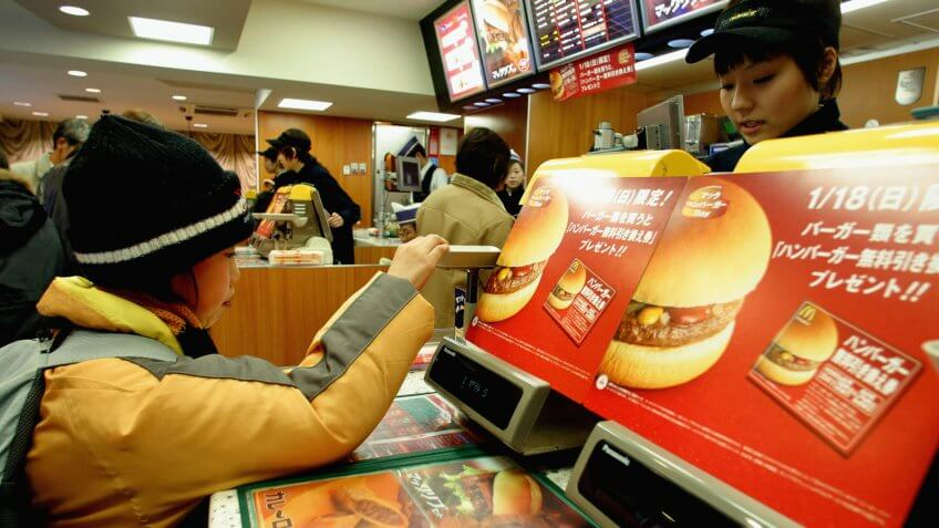 TOKYO - JANUARY 18:  A Customer makes a purchase in a McDonalds January 18, 2004 in Tokyo, Japan.