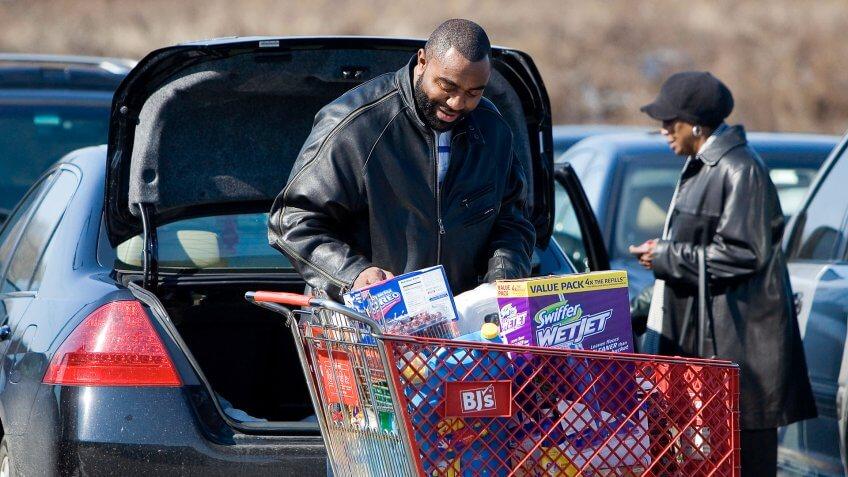 PHILADELPHIA - FEBRUARY 21: A customer loads his car after shopping at BJ's Wholesale Club February 21, 2007 in Philadelphia, Pennsylvania.
