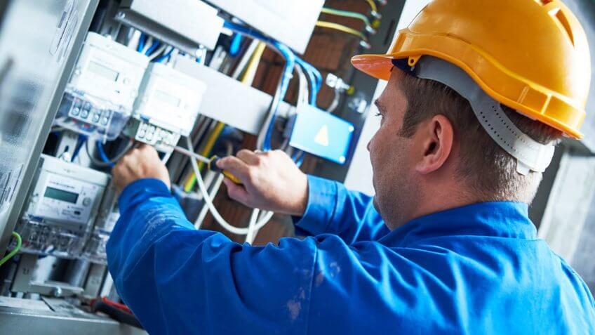Electrician installing energy saving meter.