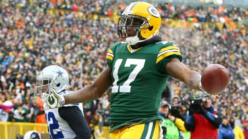 GREEN BAY, WI - JANUARY 11:   Davante Adams #17 of the Green Bay Packers reacts after scoring a touchdown in the third quarter against the Dallas Cowboys during the 2015 NFC Divisional Playoff game at Lambeau Field on January 11, 2015 in Green Bay, Wisconsin.