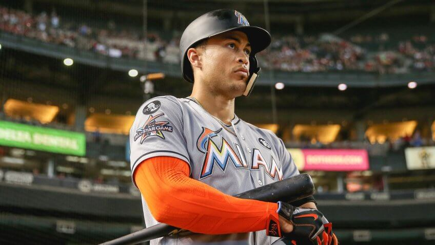 PHOENIX, AZ - SEPTEMBER 24:  Giancarlo Stanton #27 of the Miami Marlins warms up on deck during the first inning of the MLB game against the Arizona Diamondbacks at Chase Field on September 24, 2017 in Phoenix, Arizona.