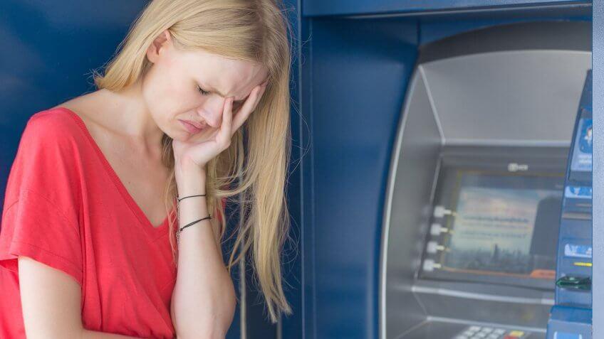 woman sad at ATM