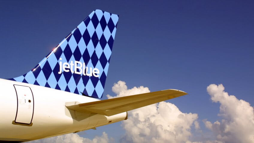 A JetBlue Airways jet sits on the tarmac June 19, 2001June 19, 2001 at the Ft.