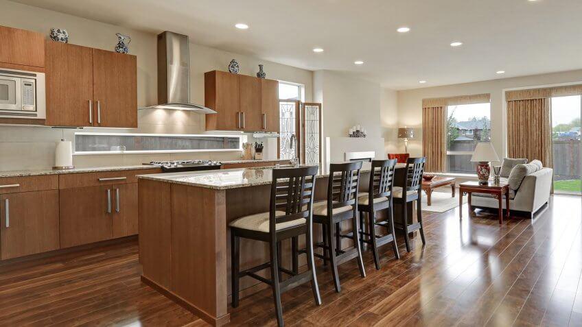 Bright modern open plan kitchen room interior.