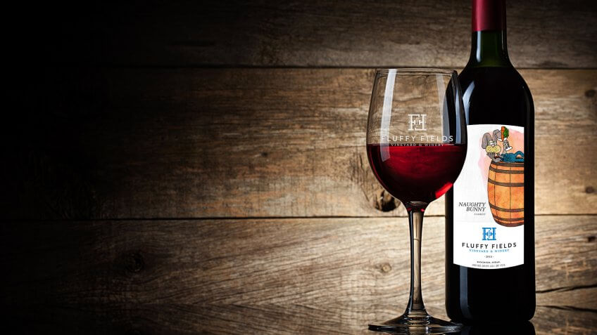 Wine glass and Bottle on a wooden background.