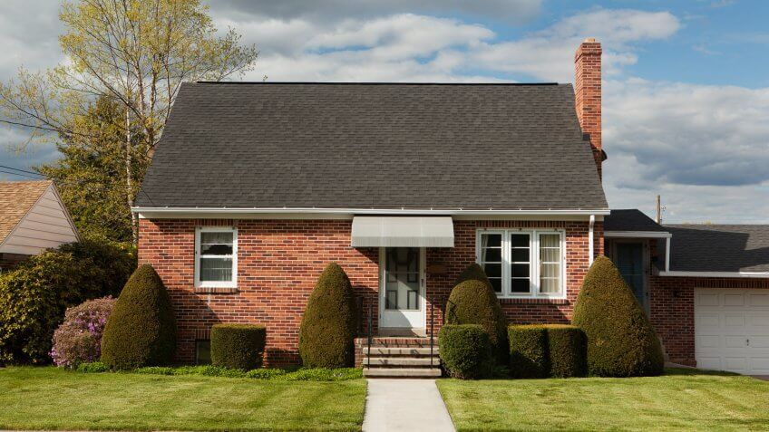 Facade of a brick bungalow.
