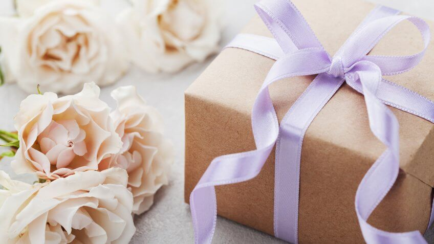 gift wrapped box and flowers
