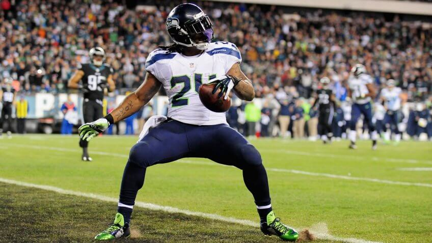 PHILADELPHIA, PA - DECEMBER 07:  Marshawn Lynch #24 of the Seattle Seahawks scores a touchdown against the Philadelphia Eagles during the third quarter of the game at Lincoln Financial Field on December 7, 2014 in Philadelphia, Pennsylvania.