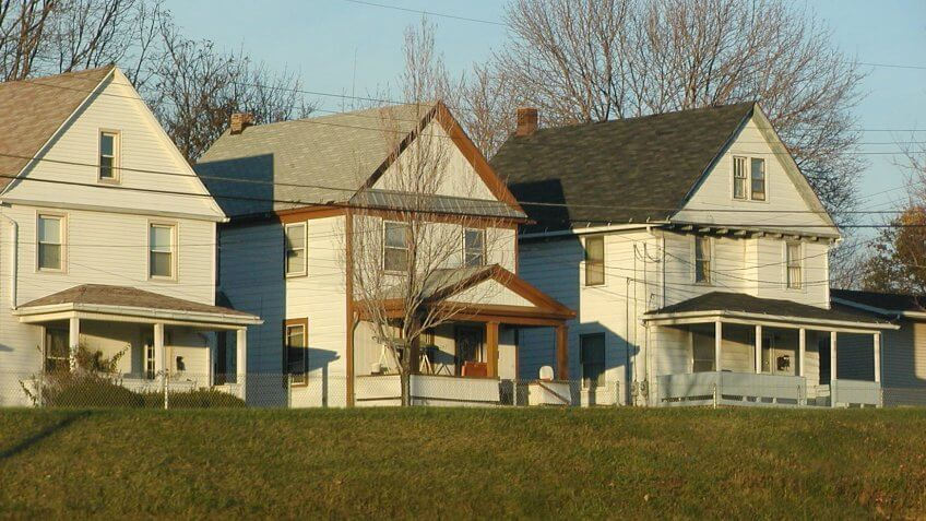 """""""Three homes in Akron, Ohio as viewed from freeway."""
