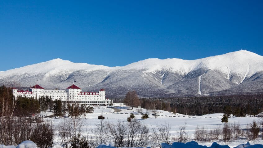 Scenic view of snow covered mountain and lodge at Mount Washington.