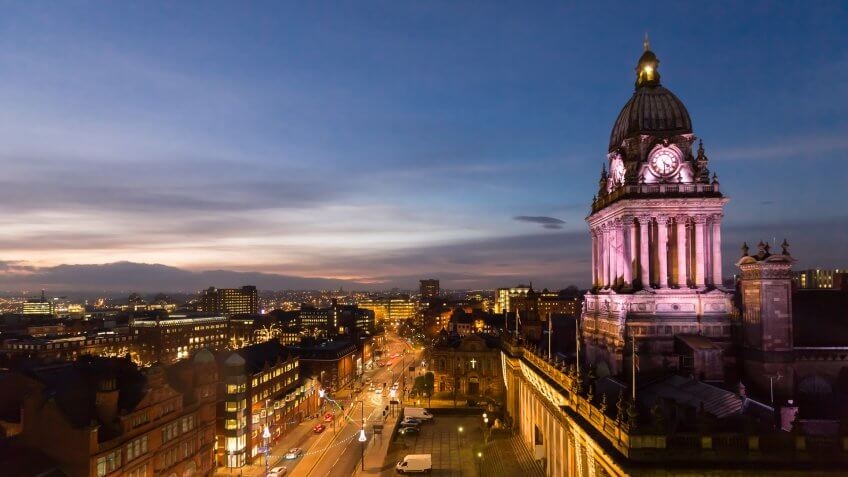 High angle view of Leeds Town Hall and panoramic night view of skyline, showing The Headrow and centre of the city.