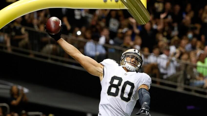 NEW ORLEANS, LA - AUGUST 15:  Jimmy Graham #80 of the New Orleans Saints celebrates a touchdown during a preseason game against the Tennessee Titans at the Mercedes-Benz Superdome on August 15, 2014 in New Orleans, Louisiana.