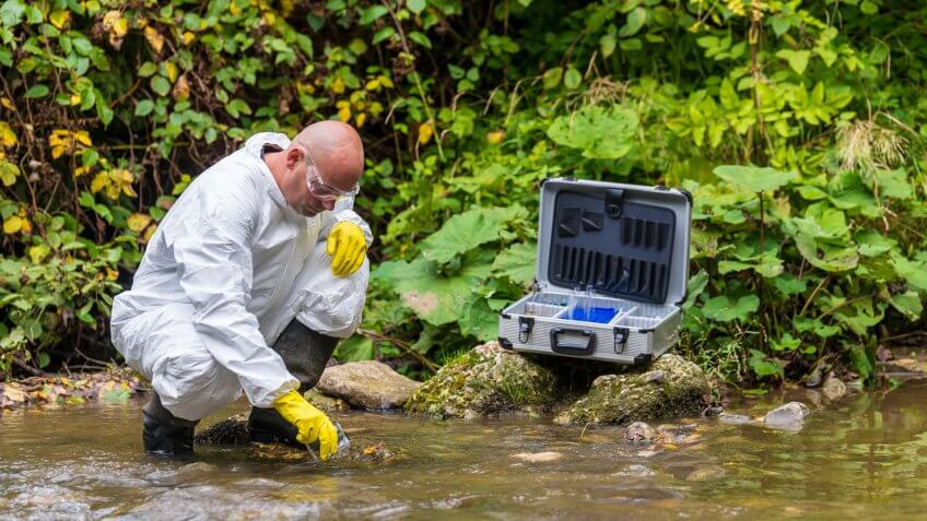 Scientist examing toxic water.
