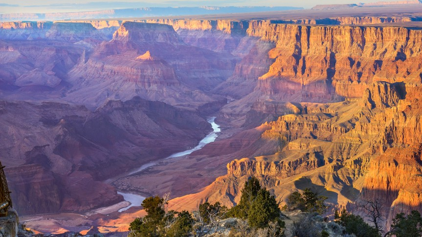 Beautiful Landscape of Grand Canyon from Desert View Point with the Colorado River visible during dusk.