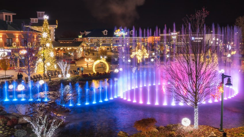 Pigeon Forge, Tennessee - December 3, 2017 : A colorful display from state of the art, multi-tiered show fountain at The Island.