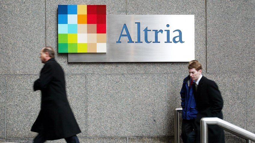 Businessmen enter the former Philip Morris offices which is now called Altria January 31, 2003 in New York City.