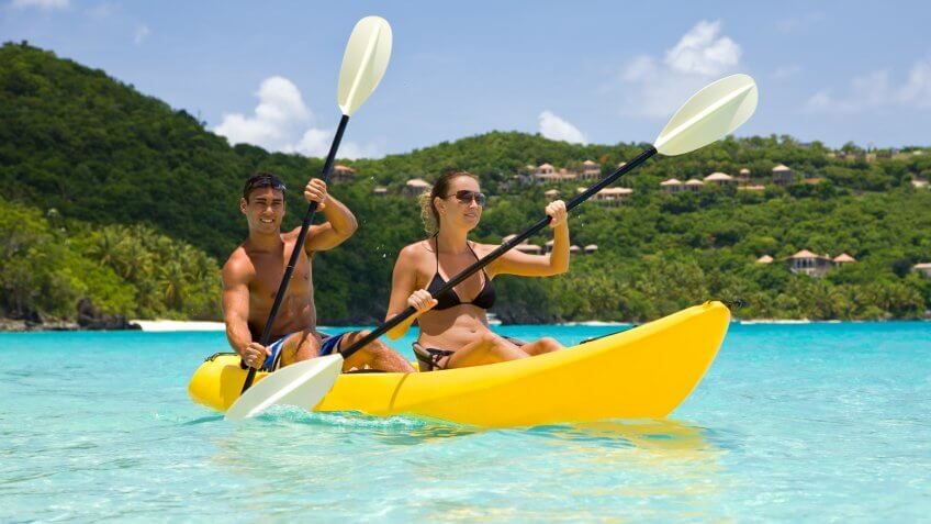 young couple kayaking in crystal clear turquoise water in the Virgin Islandsview images from the same series:.