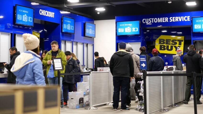 Coquitlam, BC, Canada - December 30, 2016 : People line up for buying gift at check out counter inside Best buy store.
