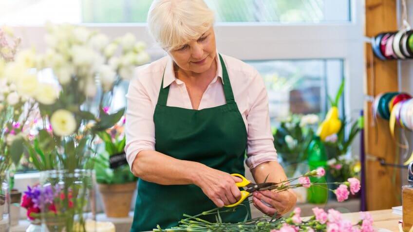 Woman working in florist shop.