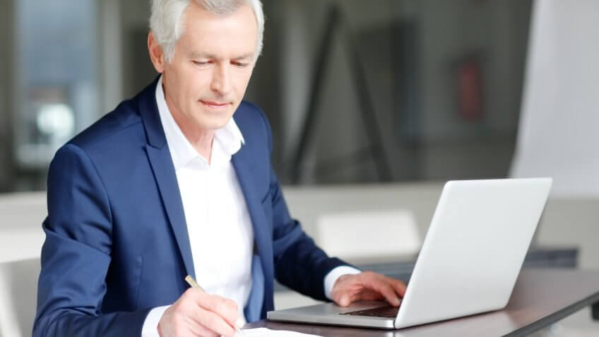executive businessman working on his laptop