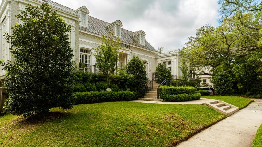 New Orleans, LA USA - April 21, 2016: Beautiful homes in the upscale historic Saint Charles Avenue area.