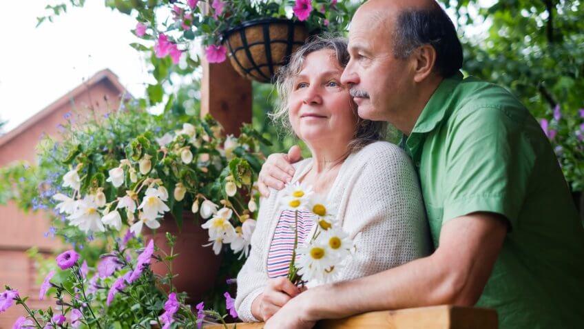 senior couple front porch