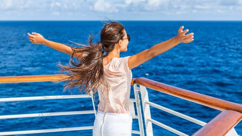 Cruise ship vacation woman enjoying travel vacation at sea.