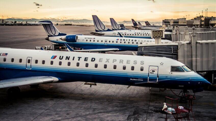 Denver, Colorado - 23 December, 2007: United Express CRJ-700 planes at gates at Denver International Airport.
