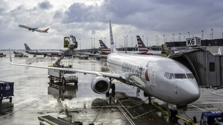 CHICAGO,UNITED STATES - JANUARY 22: Deicing of the American Airlines planes before take off on January 22, 2016 in Chicago.