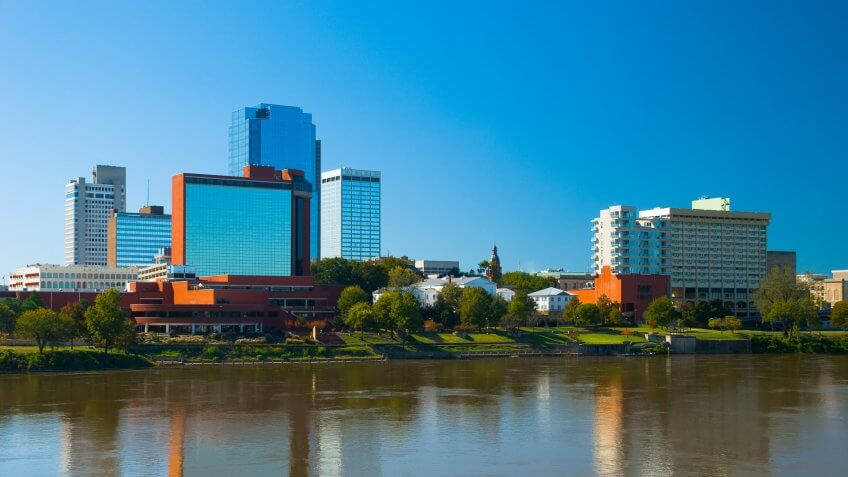 Little Rock's downtown skyline with the Arkansas River in the foreground.