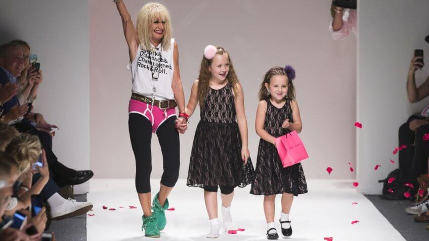 NEW YORK - SEPTEMBER 11: Designer Betsey Johnson & granddaughter walk runway during Spring/Summer 2014 Fashion week for collection by Betsey Johnson at Lincoln Center on September 11, 2013 in New York.