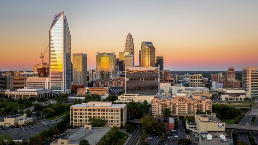 The Charlotte, North Carolina skyline seen during sunset on a colorful clear afternoon.