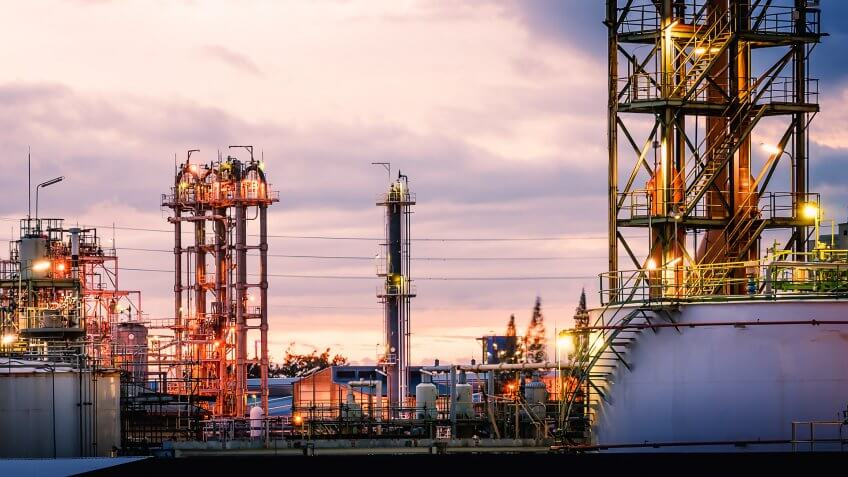 Petrochemical plant factory against the evening sunset sky