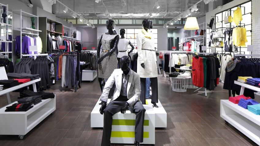 fashion store display with mannequins in clothes