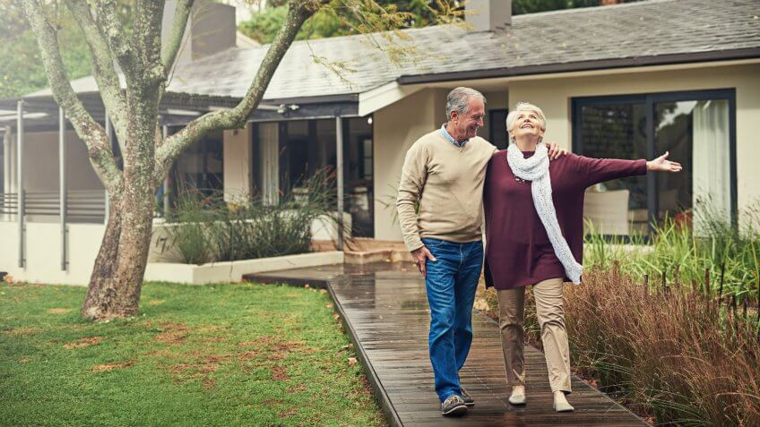 Shot of a loving senior couple taking a walk outside.